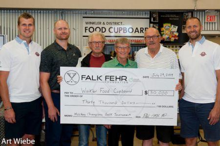 FalkFehr 2019 cheque presentation Food Cupboard.jpg
